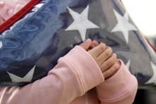 Small Hands Holding Folded American Flag 2