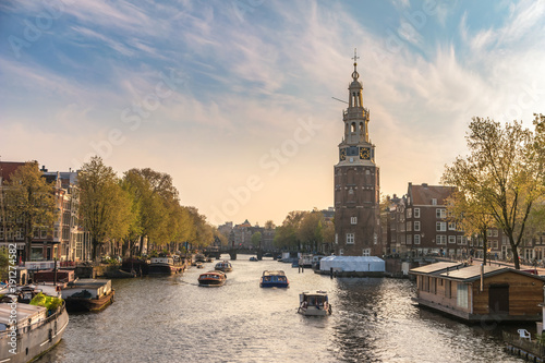 Foto op Plexiglas Amsterdam Amsterdam sunset city skyline at Montelbaanstoren Tower, Amsterdam, Netherlands