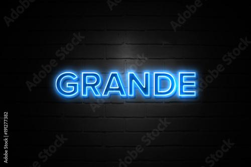 Fotografie, Obraz  Grande neon Sign on brickwall