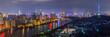 Illuminated city near river by night, Shanghai, China