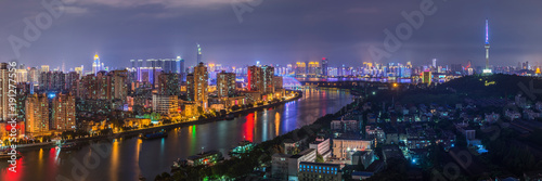 Illuminated city near river by night, Shanghai, China - 191277556