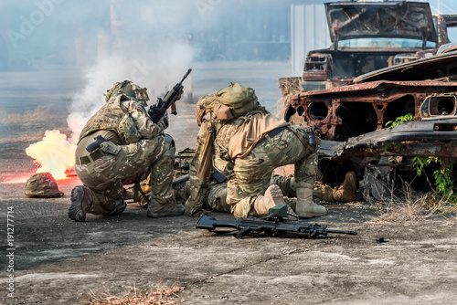 Fotografie, Obraz Infantry soldier of the elite special purpose unit during military the battle in