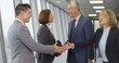 4K Smiling corporate business group meet & shake hands in modern city office. Slow motion