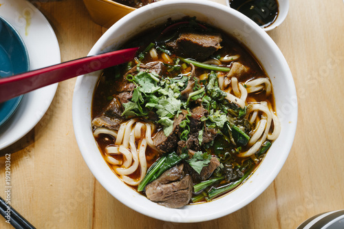 Close-up of beef noodle soup served in a bowl - 191290362