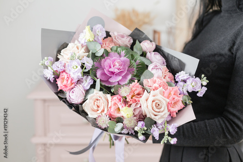 beautiful luxury bouquet of mixed flowers in woman hand. the work of the florist at a flower shop. © malkovkosta