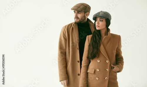 Fotografie, Tablou  Portrait of a loving couple dressed in a yellow fashion coat