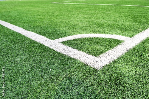 green grass football field aerial shot corner soccer field or football texture background white lines on green grass sport