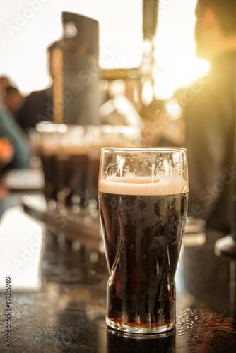Carta da parati Close up of a glass of stout beer in a bar