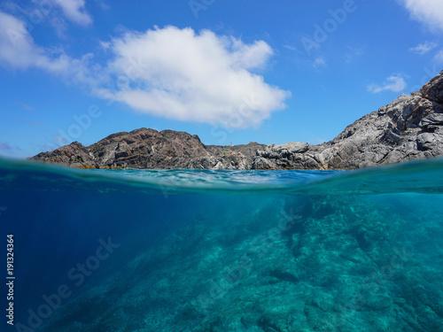Deurstickers Kust Rocky coastline and rock underwater, split view above and below water surface, Cap de Creus, Mediterranean sea, Spain, Costa Brava, Catalonia