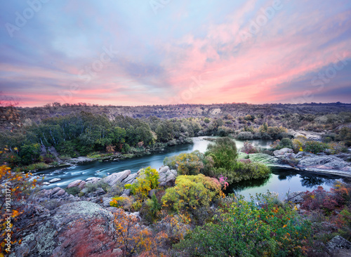 Foto op Canvas Lavendel Mountain river among the stones and trees under the dawn sky