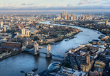 Fototapeta Londyn - Arial view of London with the River Thames and Tower Bridge at sunset