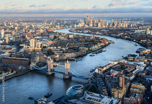 Poster London Arial view of London with the River Thames and Tower Bridge at sunset