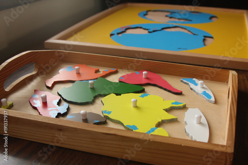 Fotografie, Obraz  continents puzzle pieces on tray