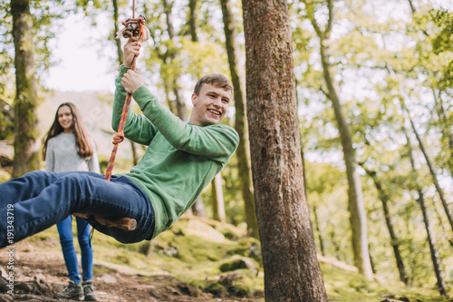 Fotografie, Obraz  Teenagers Having fun on a Rope Swing