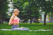 Young woman outdoors, Reverse Prayer Pose