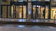 the flow of people passing through the revolving door of the office building at the end of the working day,time lapse