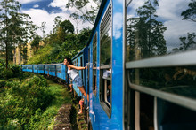 The Girl Travels By Train To B...