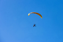 Yellow Moto-paraglider Flying ...