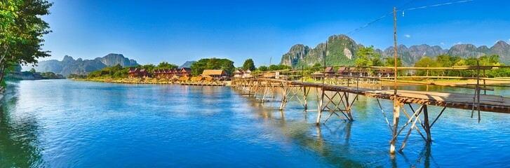 Beautiful view of a bamboo bridge. Laos landscape. Panorama