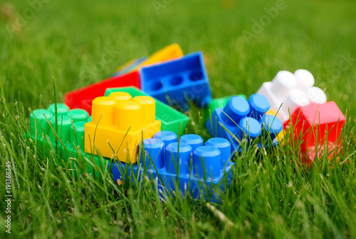 bright colored elements and blocks of the constructor on the green grass Canvas Print