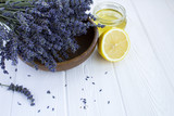 Fototapeta Lavender - Dry lavender,lemon and honey on the white  wooden background