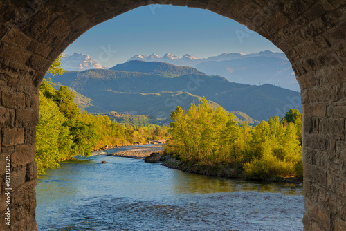 Door stickers Chocolate brown Mountainous landscape with a river and trees