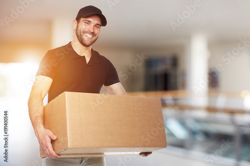 Happy delivery man with box Wallpaper Mural
