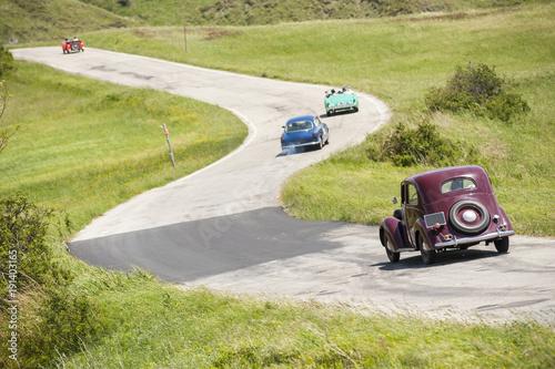 Keuken foto achterwand Vintage cars Vintage cars on winding road
