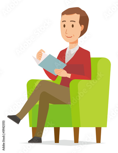 A middle-aged man wearing a sweater is reading on a sofa Wallpaper Mural
