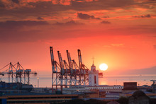 Beautiful Sunset And Industrial Cargo Cranes In Manila Bay