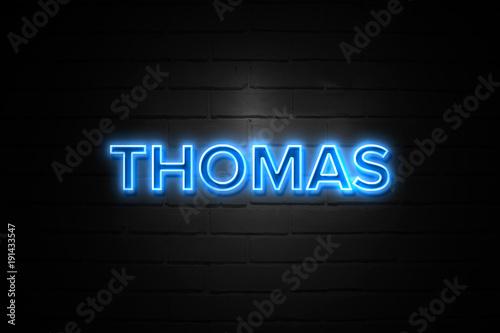 Fotografie, Obraz  Thomas neon Sign on brickwall