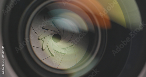Professional camera lens zooming in and out Fotobehang