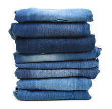 Stack Of Blue Jeans A White Ba...