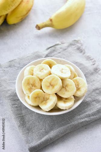 Sliced ripe banana in bowl