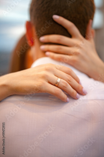 Poster Yoga school Female hands hug male's neck. Closeup.