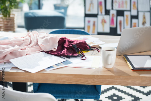 messy fashion designer workplace at modern office Canvas Print