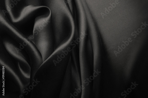 Fotobehang Stof Elegant black satin silk with waves, abstract background