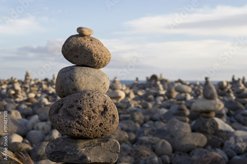Stones in stack balanced on top of each other on beach