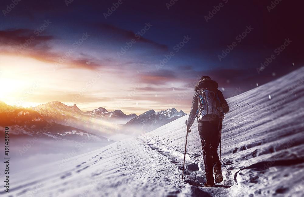 Fototapety, obrazy: Hiker walking along snowy path in mountains