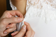 Female Seamstress Prepares Dress To The Fitting. Close Up