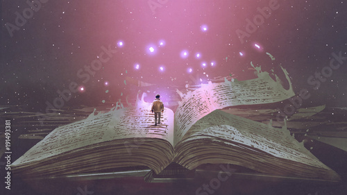 Keuken foto achterwand Grandfailure Boy standing on the opened giant book with fantasy light, digital art style, illustration painting