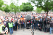 Leinwandbild Motiv Political protest. Demonstration. Microphone in focus against blurred crowd.