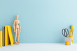 canvas print picture Pastel blue mock up young student desk, with yellow supples, mannequin, notebook and copy space.