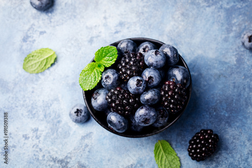 Fresh blueberry, blackberry berries, mint leaves