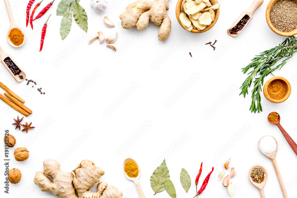 Fototapety, obrazy: Colorful dry spices in bowls and spoons near ginger, garlic, rosemary on white background top view copy space