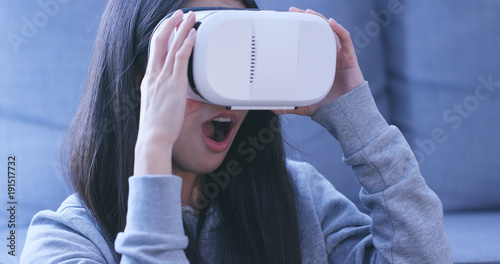 Woman wearing virtual reality device at home Wallpaper Mural
