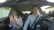 Young happy fun couple singing and dancing in the car
