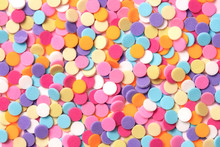 Confetti. Colorful Dots View From Above On A Light Background. Top View. Full Frame
