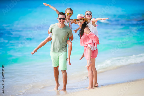 Fototapeta Young family on vacation have a lot of fun together