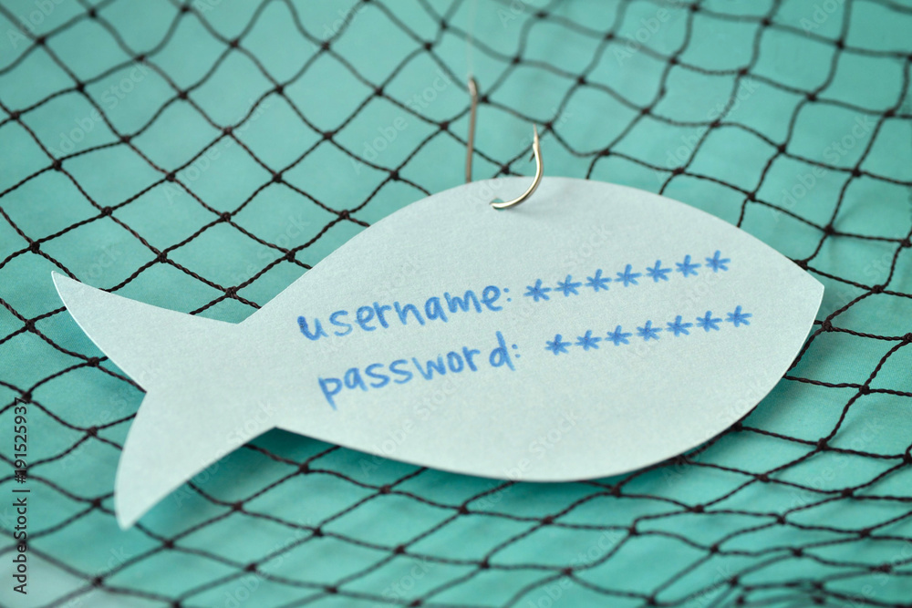 Fototapeta Username and password written on a paper note in the shape of a fish attached to a hook - Phishing and internet security concept